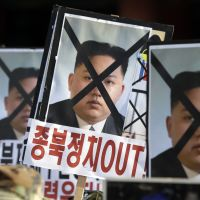 Public enemy: Protesters in Seoul brandish pictures of North Korean leader Kim Jong Un during a rally Wednesday denouncing Pyongyang's rocket launch. Some analysts fear the successful launch may inspire the North to conduct a third nuclear test. | AP