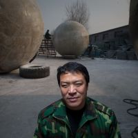 For that really rainy day: Liu Qiyuan poses with survival pods he says he created after watching the 2009 Hollywood disaster film '2012,' which is inspired by the expiry on Dec. 21 of the Mayan Long Count. | AFP-JIJI