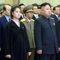 Baby bump?: Ri Sol Ju stands next to her husband, North Korean leader Kim Jong Un, during a memorial service marking the one-year anniversary of the death of Kim's father, former leader Kim Jong Il. | KYODO