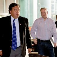 Going places: Google chief Eric Schmidt (second from right) and former New Mexico Gov. Bill Richardson leave a Beijing hotel Monday ahead of their visit to North Korea. | AP