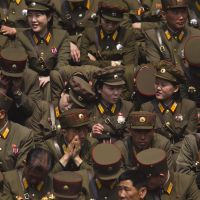 For the country: North Korean soldiers wait for a mass meeting of the ruling party to start at a stadium in Pyongyang in April. | AP