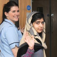 On the road to recovery: Pakistani schoolgirl Malala Yousufzai waves as she is discharged from the Queen Elizabeth Hospital in Birmingham, central England, on Jan. 3. Malala was shot last October by the Taliban after she campaigned for girls' education in her country. | AFP-JIJI