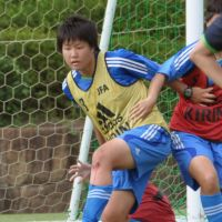 A student participates in a soccer gasshuku (training camp) in Mimasaka, Okayama Prefecture, last month. | KYODO
