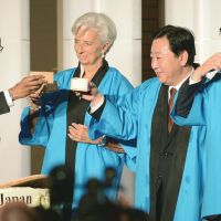 Liquid asset: IMF Managing Director Christine Lagarde (center) gets into the Japanese spirit of things during the recent IMF annual general meeting in Tokyo. | KYODO