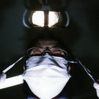 Open wide: A dentist looms over a patient.