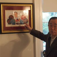 The weight of the world: U.N. Secretary General Ban Ki Moon points to a caricature of himself at his residence in New York.