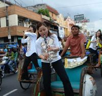 Dancing with the trannies: For the Japan Foundation-sponsored exhibition 'Kita! Japanese Artists Meet Indonesia,' musician-fine artist Chanchiki Tornade led a parade through Yogyakarta that was ultimately joined by the town's local transvestites.