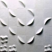 Making ripples in industrial design: Masatoshi Sakaegi's series of vessels 'Clay Wave' (1989, below), and relief tile installation 'Burare' (1993). | AICHI PREFECTURAL UNIVERSITY OF FINE ARTS AND MUSIC; PRIVATE COLLECTION
