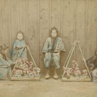 Childhood blooms: Children sell flowers in a photograph by Renjyo Shimooka  (c. 1862-78). | COURTESY OF THE TOKYO METROPOLITAN MUSEUM OF PHOTOGRAPHY