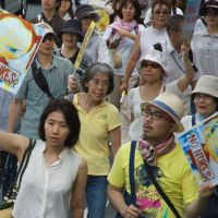 Free expression: With the artist's blessing antinuclear protesters have adopted Yoshitomo Nara's 'No Nukes Girl' as a banner during recent rallies. | MIO YAMADA