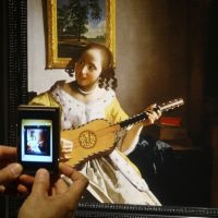 Snapshot: A visitor takes a photo of a replica of Johannes Vermeer's 'Guitar Player. | GIANNI SIMONE