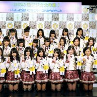 Down to earth: J-pop girl group NMB48, joined by the 'Chidejika' mascot, at an event advertising the switchover to terrestrial digital television. According to the Shukan Post, 360 billion in taxpayer money has gone into promoting the changeover. | KYODO PHOTO