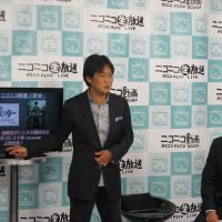 Picking up stream: Takeshi Natsuno (left), director at Dwango Co., presents Nico Nico Douga's new movie distribution service on Monday with  Taichi Fukuda, general manager of Warner Home Video and Warner Bros. Digital Distribution in Japan. | DWANGO CO.