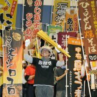 The man with the golden chopsticks: Mikihiro Ishiga, representative of the Hiruzen Yakisoba Fan Association, from the town of Miniwa in Okayama, took home the trophy for favorite dish at this year's B1 Gold Grand Prix. | KYODO PHOTO