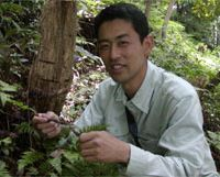 Mushroom specialist Kunihiko Otsuki examines his latest find. | WINIFRED BIRD PHOTO