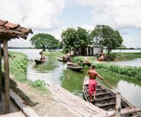 Wet life: Fishermen in the East Kolkata Wetlands head off to harvest the area's rich bounty.