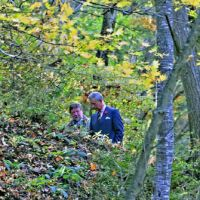 Back to nature: The Prince of Wales and C.W. Nicol share their thoughts deep in the splendid surroundings of the C.W. Nicol Afan Woodland Trust. | KENJI MINAMI PHOTO