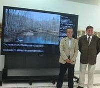 Fine sights: Myself with Norio Taori (above), president of our trust's camera benefactors, the Tokyo-based marketing research company Intage, at the unveiling of a big-screen link to our woods in the company's headquarters. | IZUMI MORITA PHOTO