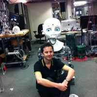 Spot the 'bot: The author together with a humanoid in the 'Aladdin's cave' of a Personal Robotics Group lab at the MIT.