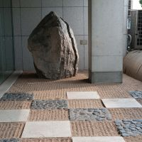 Form and textures: Parts of the garden feature patterns of stones and raked gravel, while geometric shapes draw the eye to a symbolic 'purity' cone (below).