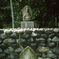Adding to the site's divinity, the pathway that circles the garden is full of ancient Buddhist statuary like this.