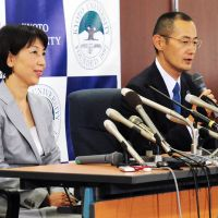 Top marks: Kyoto University Prof. Shinya Yamanaka and his wife, Chika, face the media on Oct. 9 after his award, with Cambridge University researcher John Gurdon, of a Nobel Prize in Physiology or Medicine for their work that the Nobel committee said has 'revolutionized our understanding of how cells and organisms develop.'   KYODO