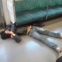 The stuff of nightmares: Whether he's flat out due to alcohol or sleep deprivation, this Tokyo train traveler is more likely than the average person to be having bad dreams.