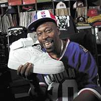 Grandmaster Caz flashes some really nice white trainers in 'Just for Kicks'