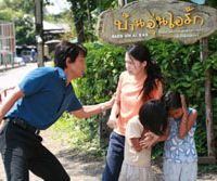 Deadly pursuit: A Japanese reporter urges Miyazaki's character to abandon her dangerous quest of rescuing children from traffickers in Thailand in 'Yami no Kodomotachi.' | © 2008 EIGA 'YAMI NO KODOMOTACHI' SEISAKU IINKAI