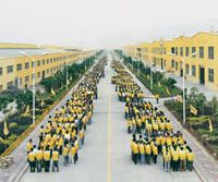 Chinese workers line up ready to get their hands dirty in 'Manufactured Landscapes.'