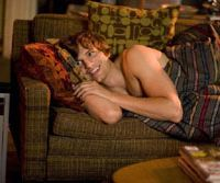 Laid-back lover: Ashton Kutcher beds down for success in 'What Happens in Vegas.'