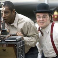 Wied-eyed: Funnyman Jack Black (right) and costar Mos Def in the movie 'Be Kind Rewind.' | © NEWLINE PRODUCTIONS/JUNKYARD PRODUCTIONS