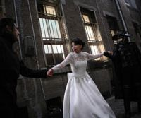 Dark knight (sort of): The Fiend with Twenty Faces and circus performer-turned-sleuth photographer Heikichi Endo fight over the impeccably upper-crust Yoko Hashiba in scenes from 'K-20 — Kaijin Nijumenso-den'   © 2008 'K-20' SEISAKU IINKAI