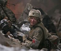 Action woman: Nadezhda Mikhalkova, who appeared as a 6-year-old in military flick 'Burnt by the Sun,' returns 17 years on for its sequel.   © 2010, GOLDEN EAGLE