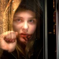Bloodlust: Chloe Moretz plays Abby, a child who harbors a dark proclivity for the red stuff, in 'Let Me In.' Saeed Adyani   ©2010 Fish Head Productions, LLC All Rights Reserved.