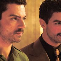 Double trouble: Actor Dominic Cooper plays both Uday Hussein and his body-double, Latif Yahia, in 'The Devil's Double.' Below: Uday Hussein was notorious for his mistreatment of women while his father, Saddam, ruled Iraq. Uday (along with his brother Qusay, and Qusay's son Mustapha) was killed by U.S. forces in a house in Mosul, Iraq, on July 22, 2003. | (C) FILMFINANCE VI 2011 — ALL RIGHTSRESERVED