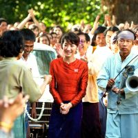 Lady in red: Michelle Yeo captures Aung San Suu Kyi perfectly in Luc Besson's bio-pic of the Burmese dissident's life. | © 2010 EuropaCorp — Left Bank Pictures — France 2 Cinema