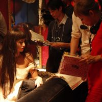 Role playing: Mika Ninagawa (right) goes over a scene with actress Erika Sawajiri, on the exuberant set of 'Helter Skelter.' | © 2012 'HELTER SKELTER' FILM PARTNERS