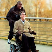 Fast friends: Quadriplegic aristocrat Philippe (François Cluzet) learns a thing or two about life from his Senegalese immigrant carer Driss (Omar Sy) in hit French film 'Intouchables.' | © 2011 SPLENDIDO / GAUMONT / TF1 FILMS PRODUCTION / TEN FILMS / CHAOCORP