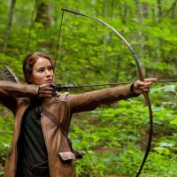 Survival of the hungriest: Katniss Everdeen (Jennifer Lawrence) fights for survival in the first of four movies based on hit young-adult novel series 'The Hunger Games.' The Hollywood film has drawn comparisons from critics (including ours) with the ultra-violent Japanese teen-on-teen classic 'Battle Royale,' though its tone is not quite as heavy. | © 2012 LIONS GATE FILMS INC. ALL RIGHTS RESERVED.