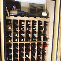 Even in a modest-size wine cellar such as the author's above, it's easy to lose track of what's there and what's best to drink. As collections increase to enormous sizes (below), record-keeping becomes essential. | WILLIAM CAMPBELL PHOTOS