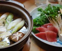 Negima-nabe (above), a hot pot featuring negi leeks and maguro tuna, is served at Yoshiume. | ROBBIE SWINNERTON PHOTOS