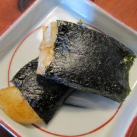 One classic way to eat mochi is as isobe-mochi, square cakes coated in dark soy sauce and wrapped in nori