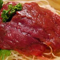 Some like it raw: Basashi (lean raw horse meat, above) is a popular side dish. Right: Sashimi-ready fish, known as saku, can be easily bought on the high street to prepare at home.