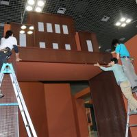 Sweet job: Staff at 'Chocolate: The Exhibition' finish building the entrance gate, made from real chocolate.   SATOKO KAWASAKI