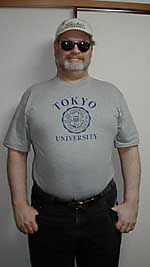 The author displays his recent 3-L T-shirt acquisition from the University of Tokyo's Co-op store.