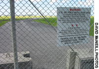 A warning sign is posted outside one of the many U.S. military facilities based in Okinawa.