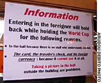 A sign erected at the entrence to a pachinko parlor outside Sapporo's main train station during the soccer World Cup 2002 bears mangled English that attempts to explain to foreign visitors that their custom is not welcome.