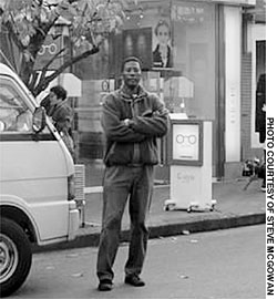 Steve McGowan stands near the eyeglass shop at the center of his lawsuit, in Daito City, Osaka Prefecture.