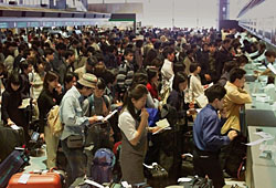 Holidaygoers line up at airline check-in counters at New Tokyo International airport, Narita. | AP PHOTO
